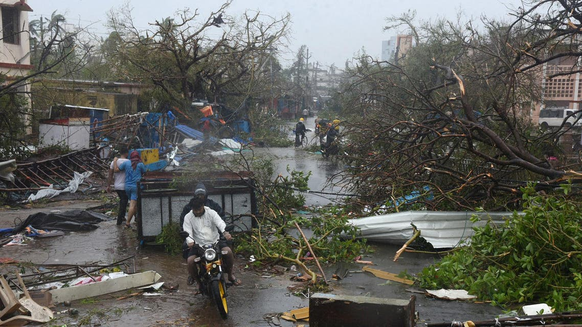 People ride a motorbike through debris on a road after Cyclone Fani hit Puri (reuters)