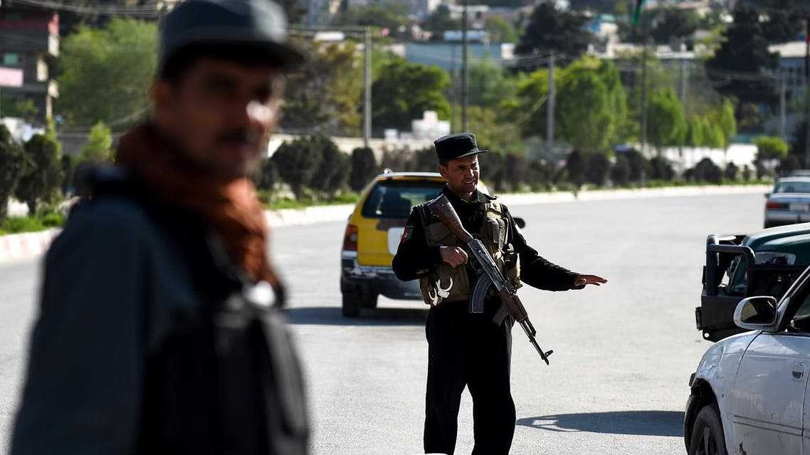An Afghan policeman gestures towards a car at a checkpoint in the city in Kabul on April 30, 2019. (AFP)