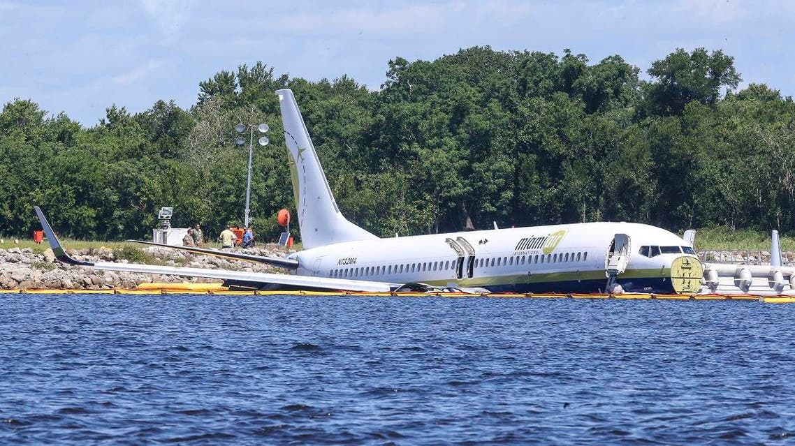 A charter plane carrying 143 people and traveling from Cuba to north Florida sits in a river at the end of a runway. (AP)