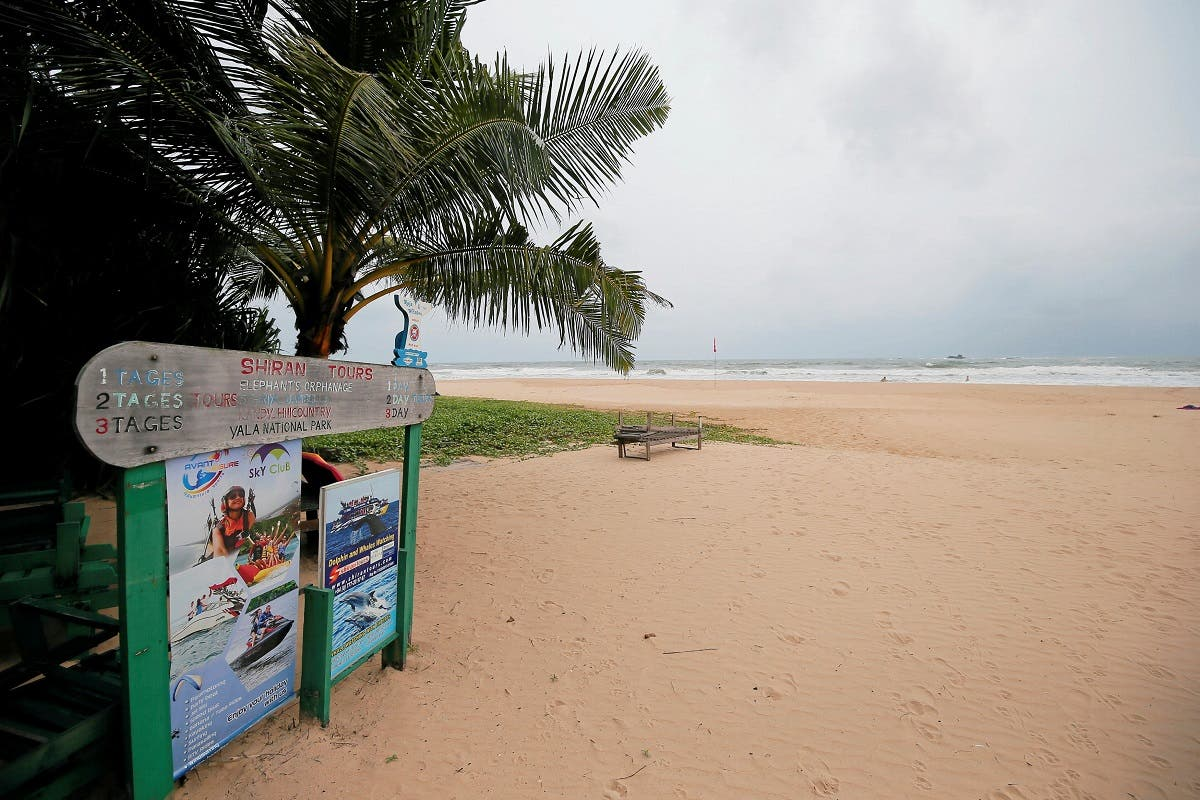 An empty beach is seen near a sign of the boat safari and whale watching center in a tourist area in Bentota. (ReuterS)