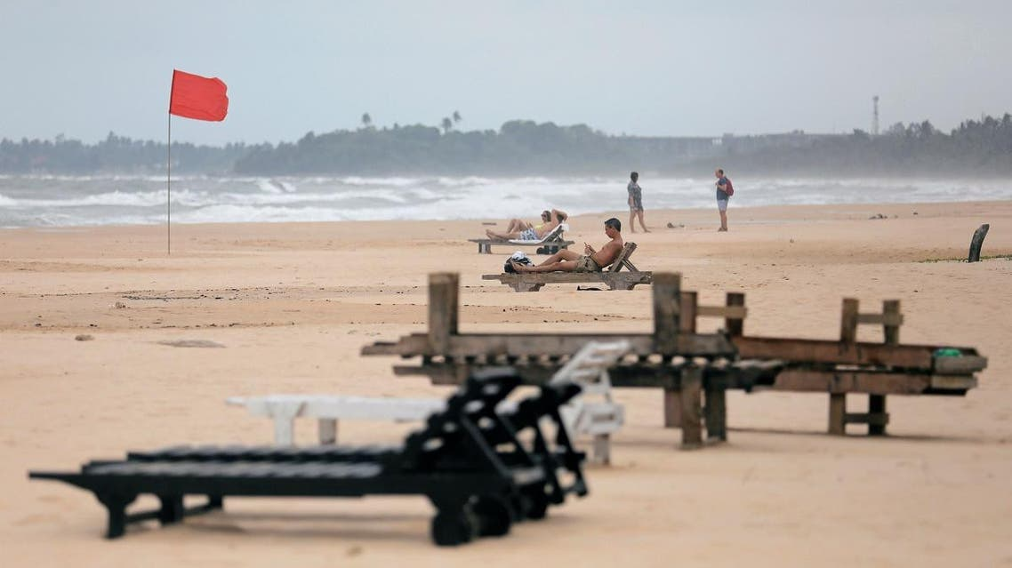 Empty sunbathing chairs are seen on a beach near hotels in a tourist area in Bentota. (Reuters)