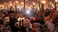 Shared meals and torch-lit parades: Indonesia Muslims welcome Ramadan