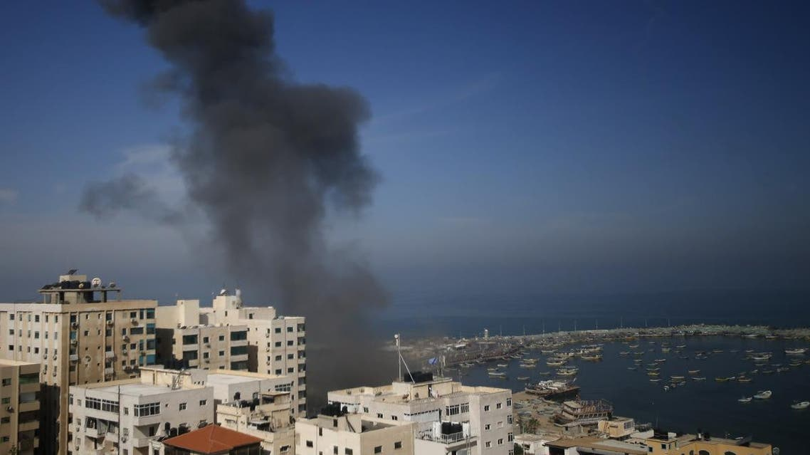 Smoke billows above buildings in Gaza City during an Israeli airstrike on the Palestinian enclave on May 5, 2019. (AFP)