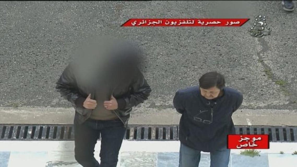 Algerian Television showed the defendants entering the court near a military base, 40 km from Algiers. (Photo courtesy: Algerian Television)