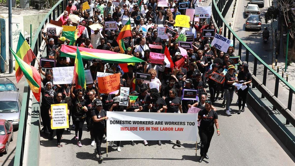 Migrant domestic workers carry placards during a protest in the Lebanese capital Beirut on May 5, 2019. (AFP)