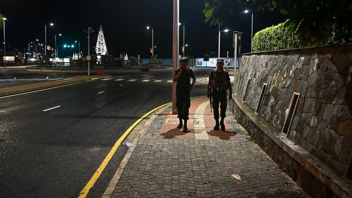 Sri Lankan soldiers patrol along a street during a curfew in Colombo on April 22, 2019, a day after the series of bomb blasts targeting churches and luxury hotels in Sri Lanka. (AFP)