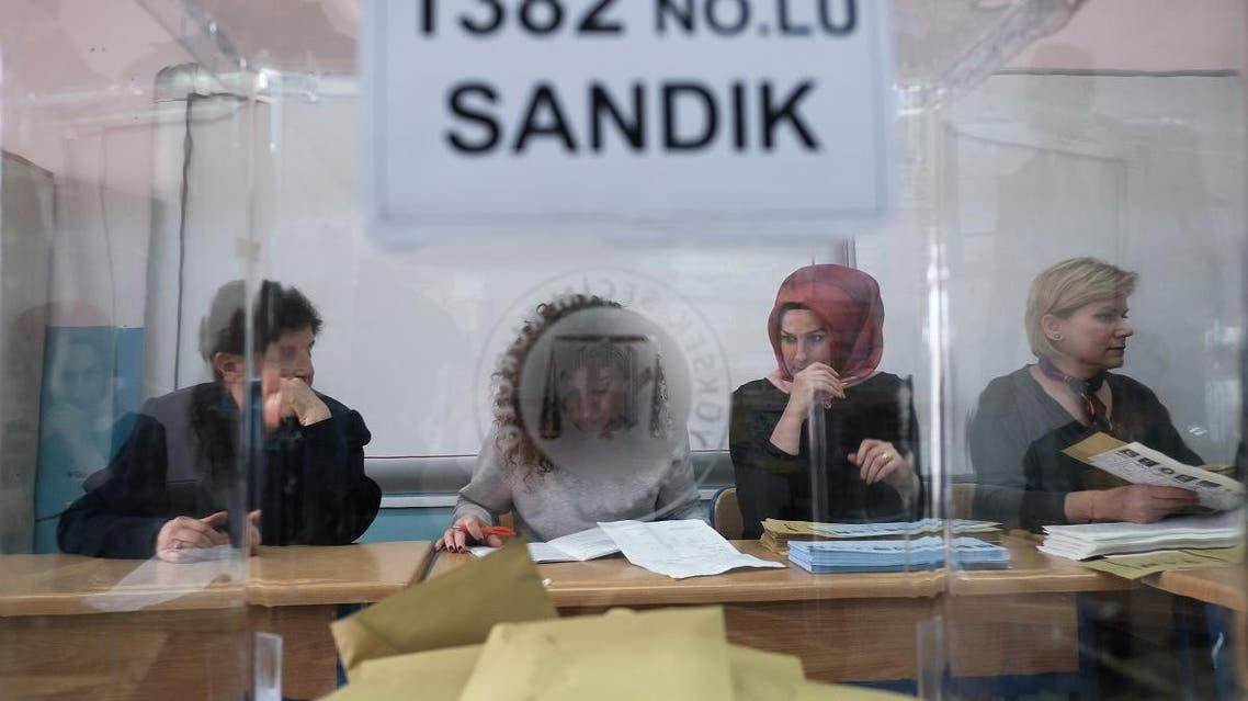 Election officials are seen through a ballot box work at a polling station during local elections in Istanbul. (File photo: AFP)