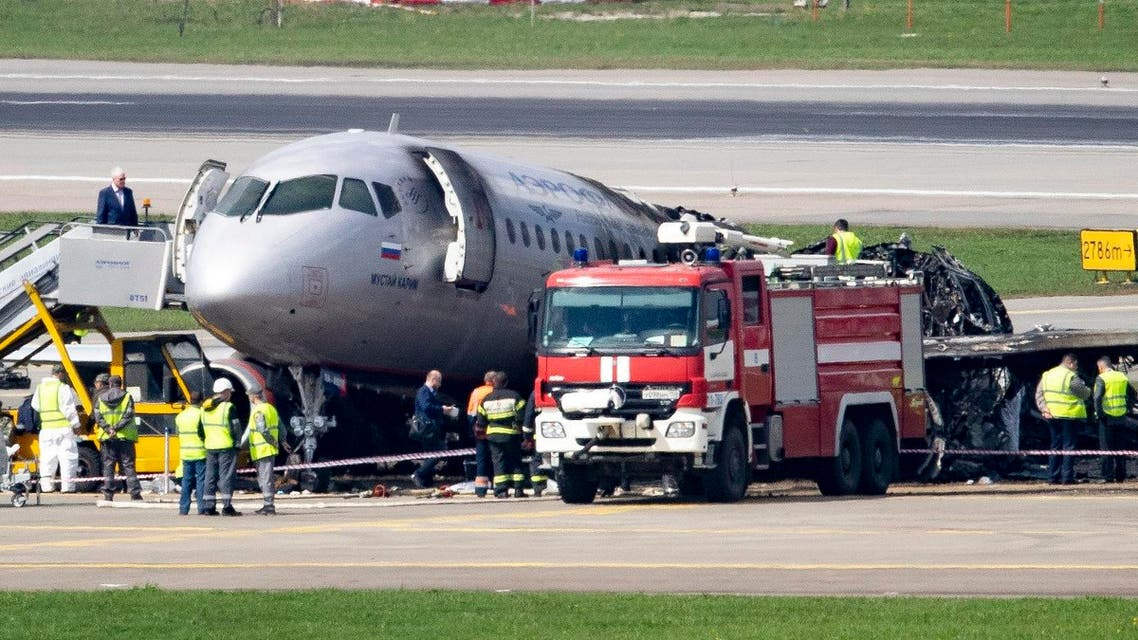People gather around the damaged Sukhoi SSJ100 aircraft of Aeroflot Airlines at Sheremetyevo airport, outside Moscow, Russia, Monday, May 6, 2019. (AP)