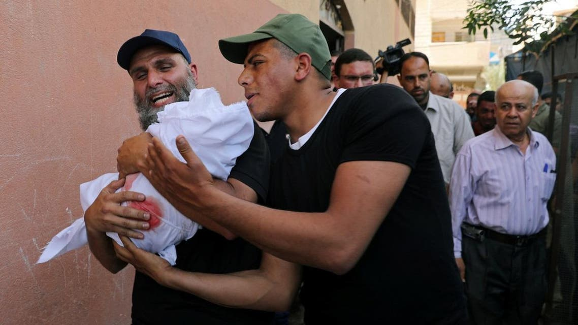 Relatives carry the body of 4-month old Palestinian baby girl Maria Al-Ghazali during her funeral, in Gaza City. (Reuters)
