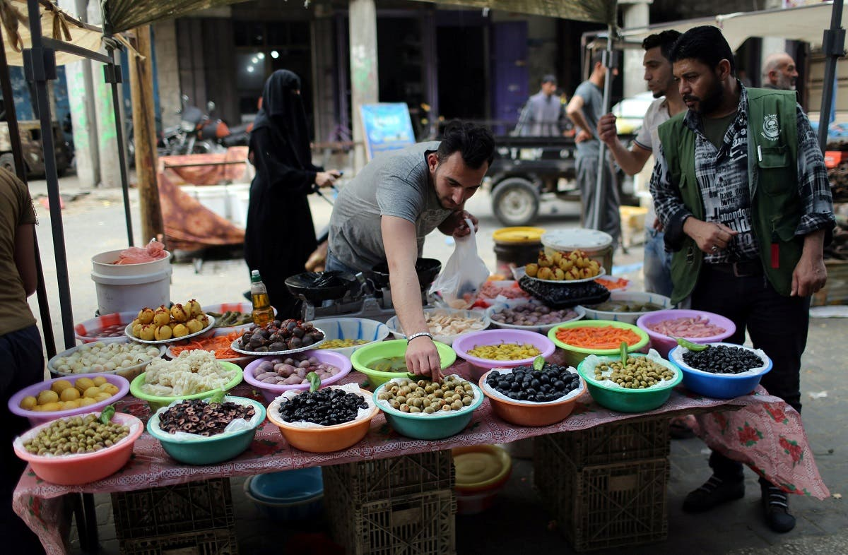 Palestinian man sells olives and pickles on the first day of the Muslim holy month of Ramadan, in the southern Gaza Strip. (Reuters)