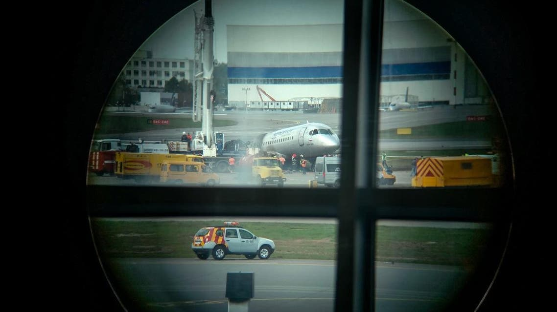 A picture taken from the airport window shows remains of a Russian-made Superjet-100 at Sheremetyevo airport outside Moscow. (AFP)
