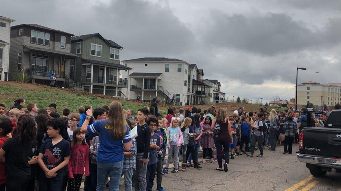 People wait outside near the STEM School during a shooting incident in Highlands Ranch, Colorado, U.S. in this May 7, 2019 image obtained via social media. (Reuters)