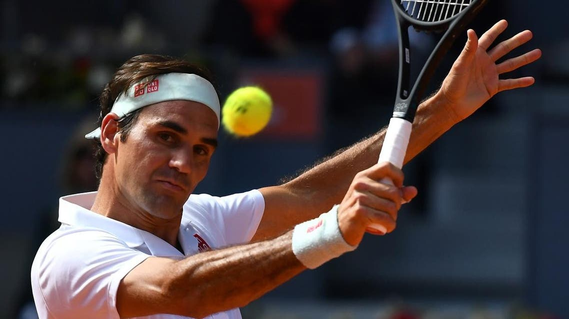 Roger Federer returns the ball to Gael Monfils during their ATP Madrid Open round of 16 tennis match at the Caja Magica in Madrid on May 9, 2019. (AFP)