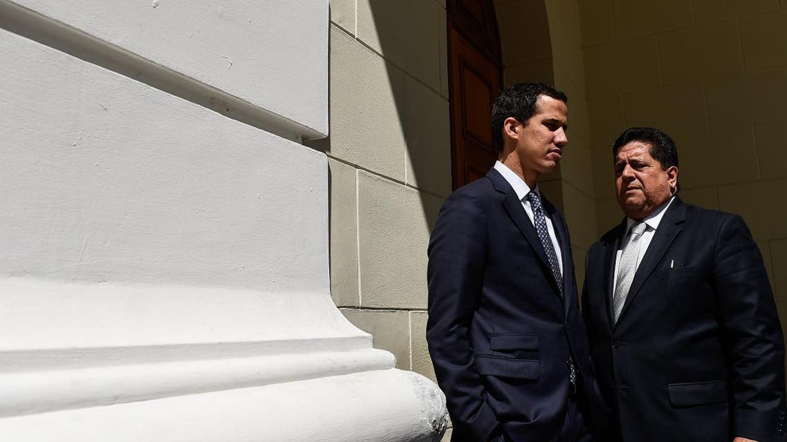The president of Venezuela's opposition-led National Assembly, Juan Guaido (L), talks with first vice president Edgar Zambrano. (AFP)