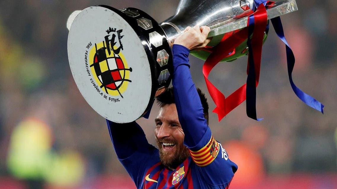 Barcelona's Lionel Messi celebrates winning La Liga with the trophy at Camp Nou, Barcelona, on April 27, 2019. (Reuters)