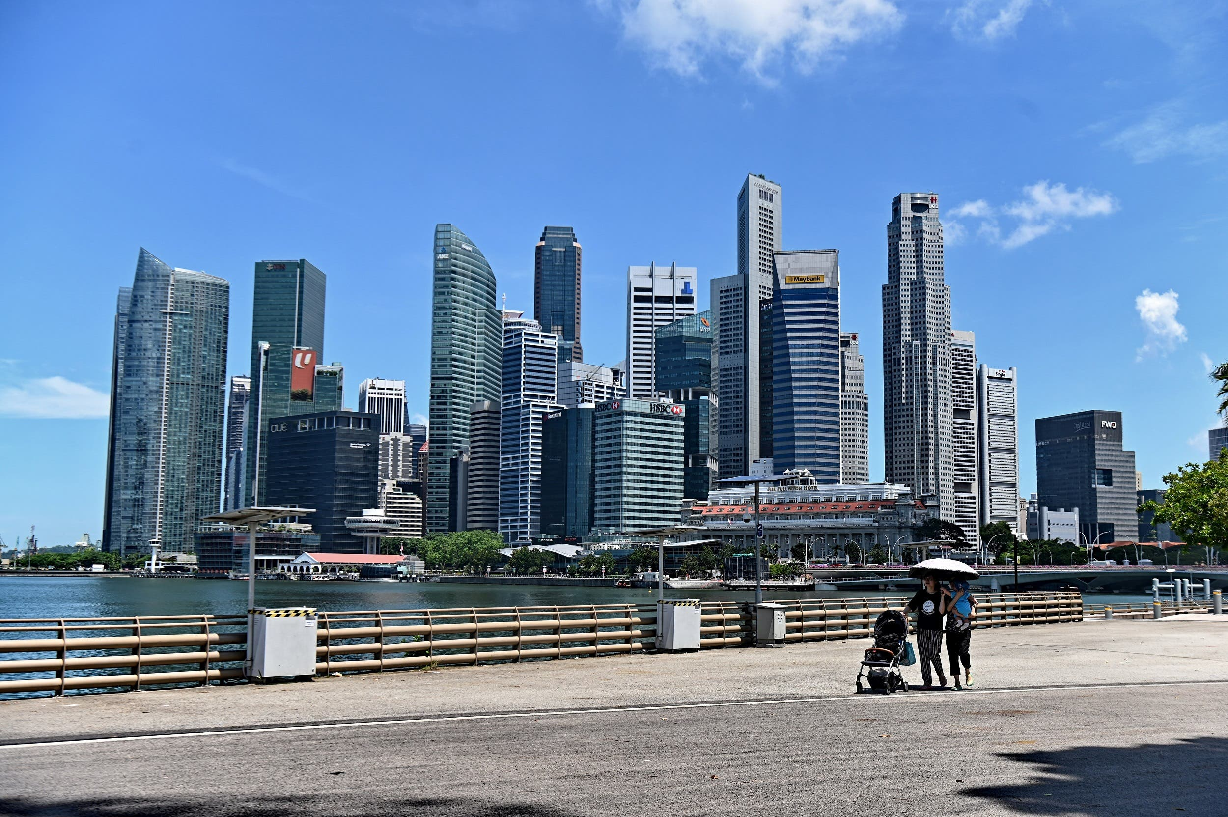 People walking near the central business district in Singapore on May 6, 2019. (AFP)