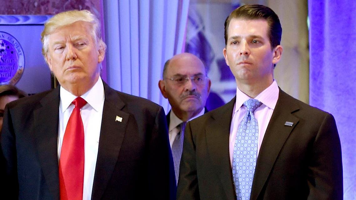 File photo of US President-elect Donald Trump along with his son Donald, Jr., during a press conference at Trump Tower in New York. (AFP)