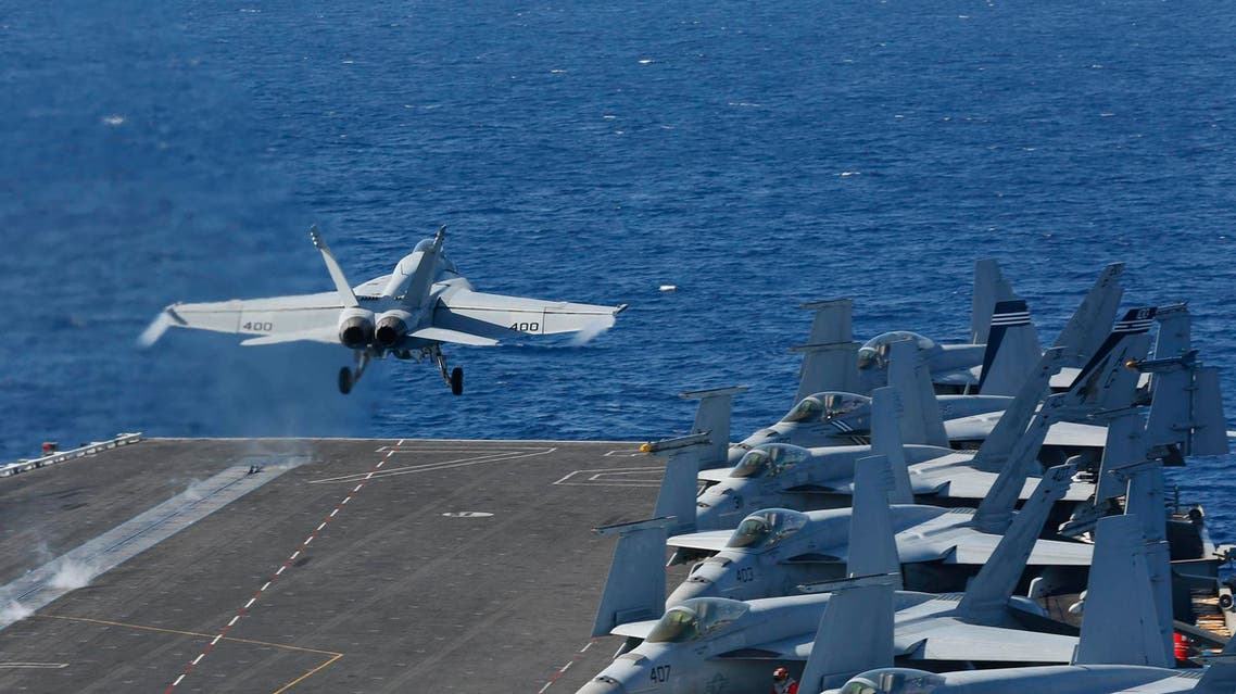 An F/A-18E Super Hornet launches from the flight deck of the aircraft carrier USS Abraham Lincoln on May 3, 2019. (AP)