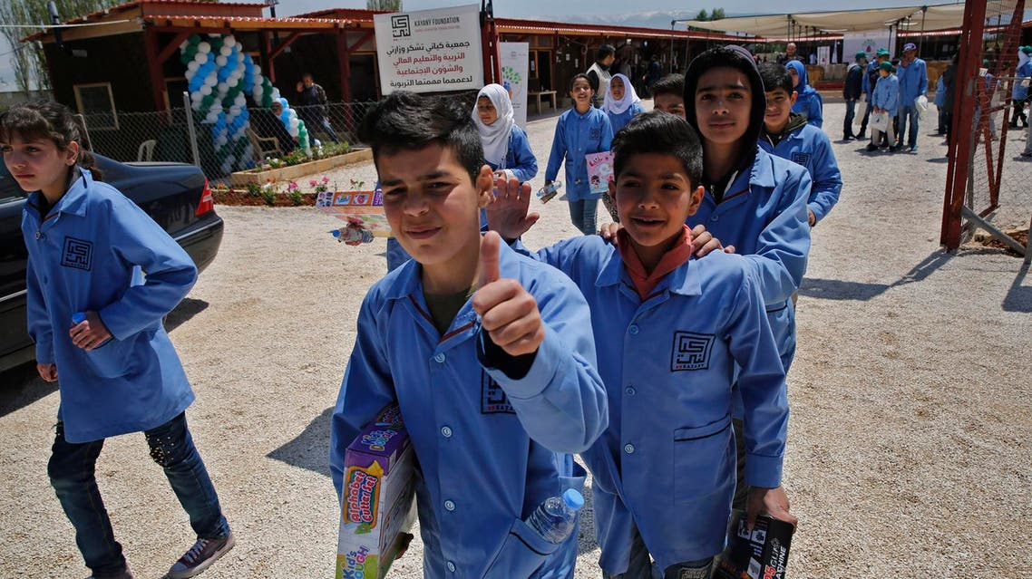 Refugee students leave their makeshift school in the Bekaa valley town of Saadnayel, east Lebanon, on April 23, 2019. (AP)