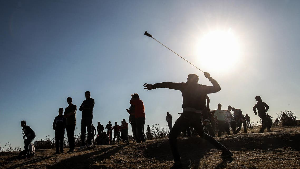 A Palestinian protester hurls stones at Israeli troops during a demonstration near the border with Israel, east of Gaza City, on May 10, 2019. (AFP)