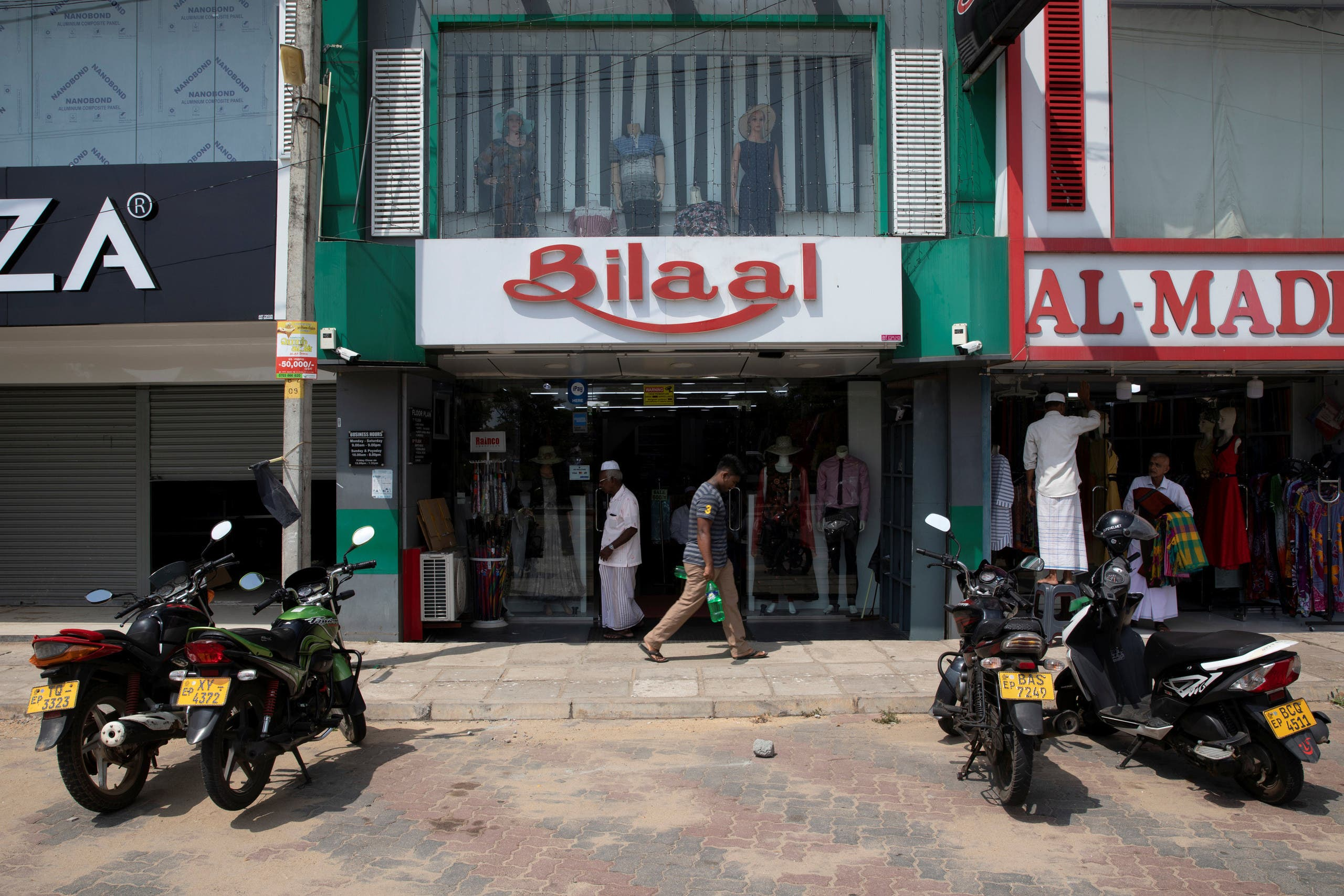 Shops owned by Muslim businessmen are seen in a market in Batticalao, sri lanka (Reuters)