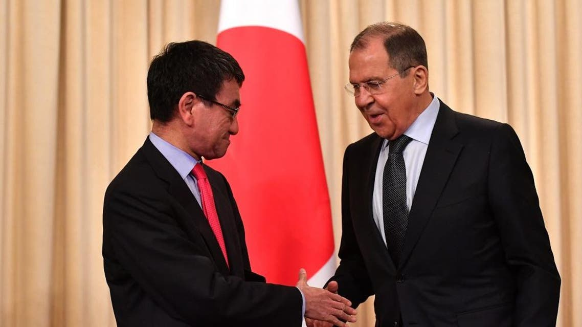 Russian FM Sergei Lavrov shakes hands with Japanese FM Taro Kono after their news conference in Moscow. (AFP)