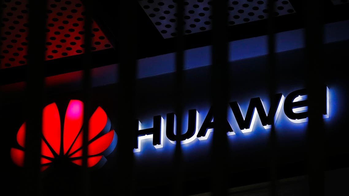 A logo of Huawei retail shop is seen through a handrail inside a commercial office building in Beijing. (AP)