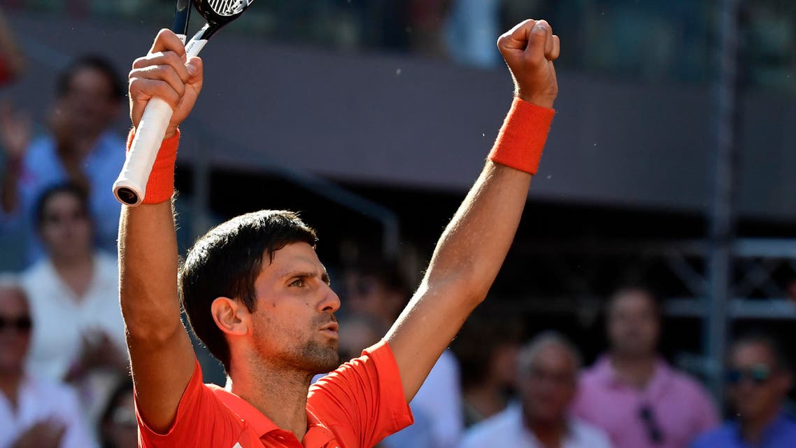 Novak Djokovic celebrates after defeating Dominic Thiem during their ATP Madrid Open semi-final tennis match at the Caja Magica in Madrid on May 11, 2019. (AFP)