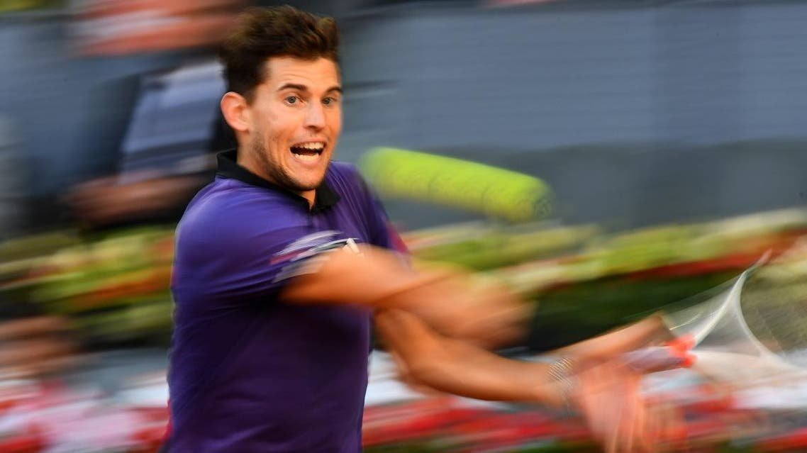 Dominic Thiem returns the ball to Roger Federer during their ATP Madrid Open quarter-final tennis match at the Caja Magica in Madrid on May 10, 2019. (AFP)