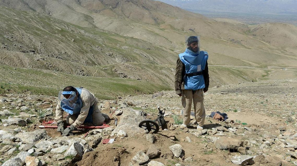 A file photo of Afghan deminers clearing mines from a field in Sangaw village, on the outskirts of Kabul. (AFP)