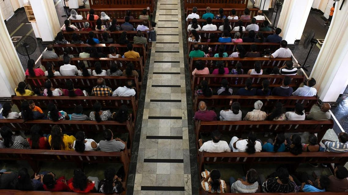Sri Lankan Catholic devotees pray during a mass at the St. Theresa's church as the Catholic churches hold services again. (AFP)