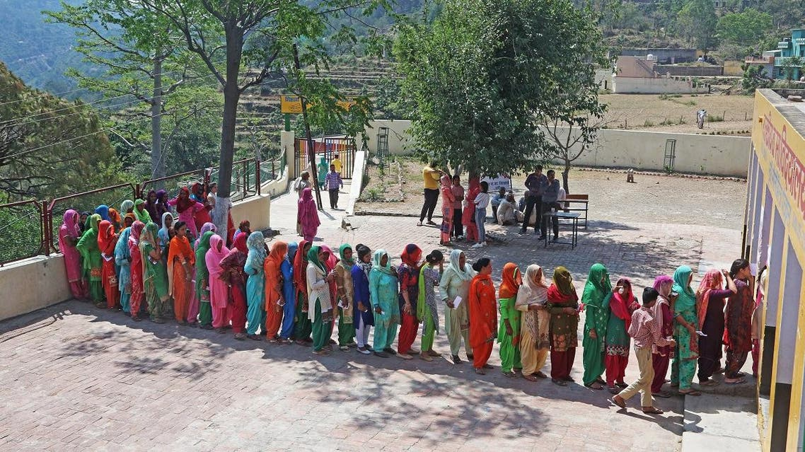 Women stand in a queue to cast their vote at a polling station in village Bhudi. (Reuters)