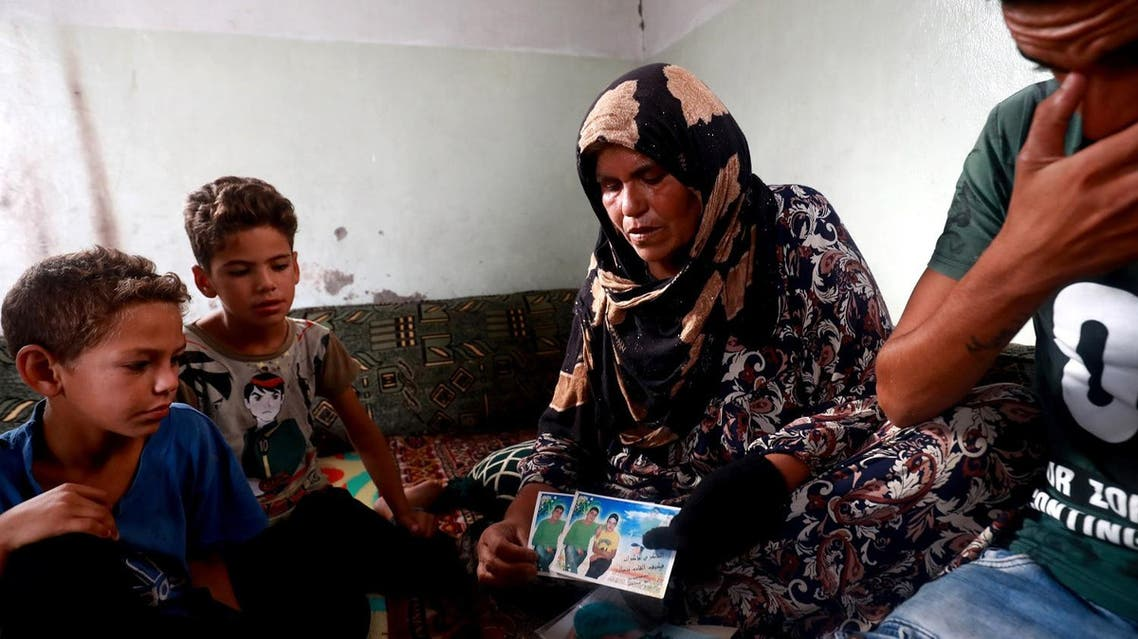 Zarifa Mahmoud Nazzal shows pictures as she speaks of her search for her missing son, Moussa, who was captured three years ago by the Islamic State group in Raqa, on October 14, 2018.