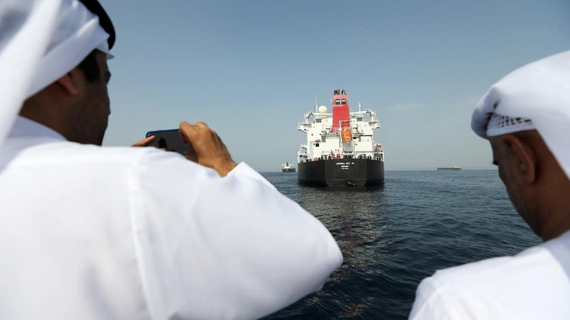 Port officials take a photo of a damaged Andrea Victory ship at the Port of Fujairah. (Reuters)
