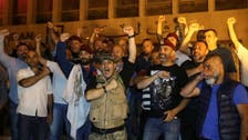 Retired Lebanese soldiers picket central bank over cuts