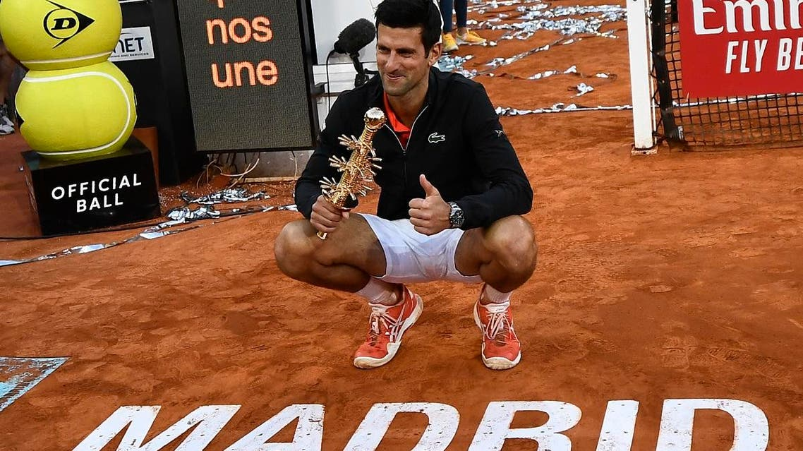 Novak Djokovic poses with his trophy after winning the ATP Madrid Open final tennis match at the Caja Magica in Madrid on May 12, 2019. (AFP)