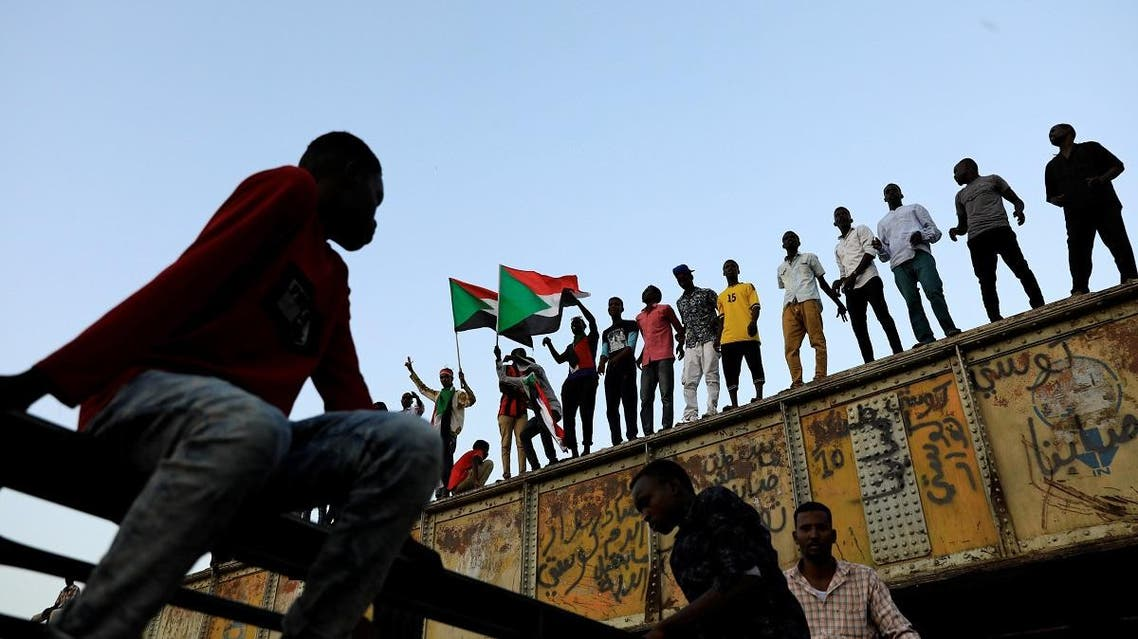 Sudanese protesters attend a demonstration in front of the defense ministry compound in Khartoum. (Reuters)