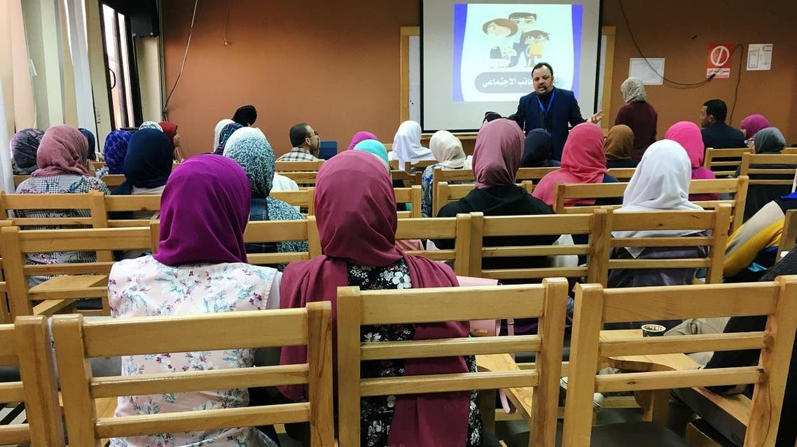 Teacher Salah Ahmed talks to students about how to handle conflicts in marriage during a recent lesson at Cairo University as part of a new government project, in Cairo, Egypt. (Reuters)