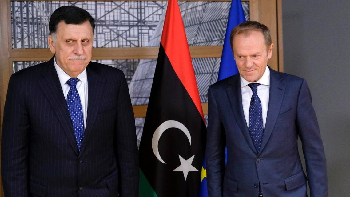 President of the European Council, Donald Tusk (R) welcomes Libyan Prime Minister Fayez al-Sarraj prior to a meeting in Brussels on May 13, 2019. (AFP)
