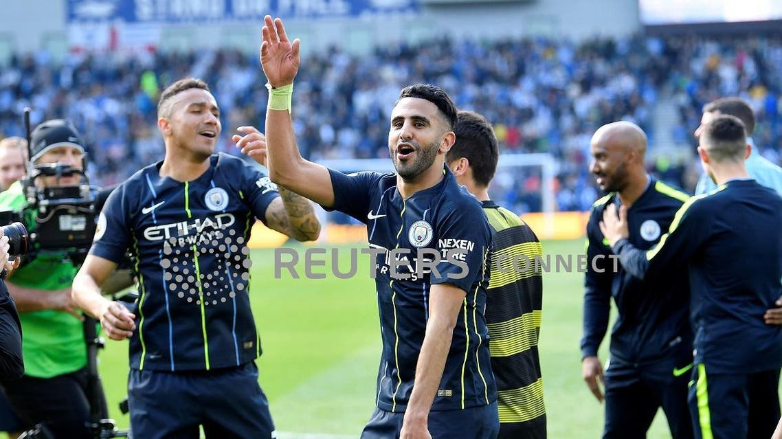 Manchester City's Riyad Mahrez (R) and Danilo celebrate winning the Premier League on May 12, 2019. (Reuters)
