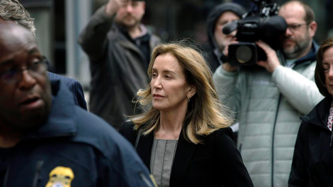 Felicity Huffman arrives at federal court Monday, May 13, 2019, in Boston, where she pled guilty to charges in a nationwide college admissions bribery scandal. (AP)