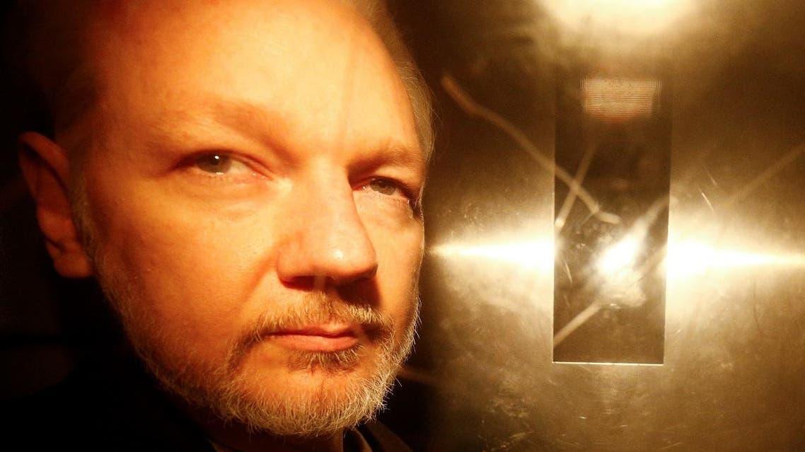 WikiLeaks founder Julian Assange leaves Southwark Crown Court after being sentenced in London. (Reuters)