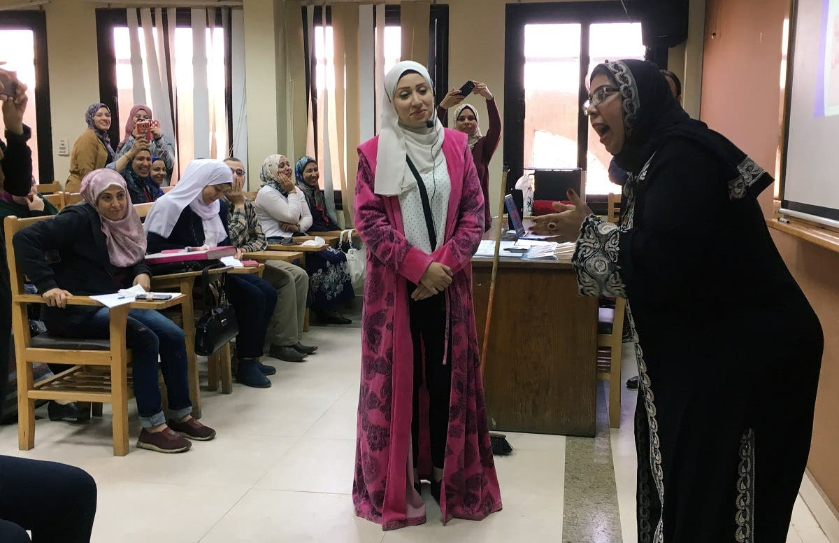 Students perform a skit at Cairo University as part of a new government project aimed at curbing Egypt's divorce rate, in Cairo, Egyp. (Reuters)