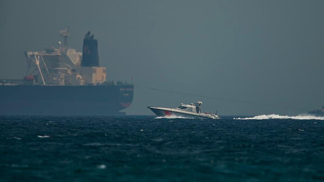 An Emirati coast guard vessel passes an oil tanker off the coast of Fujairah. (AP)