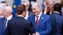 Macron wants to meet Libya's Haftar to push ceasefire: French foreign minister