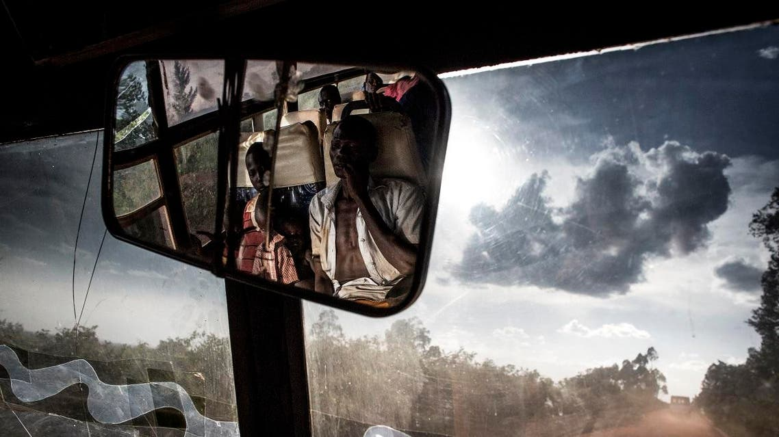 South Sudanese refugees transported by bus from the border of South Sudan to a refugees settlement site in Democratic republic of the Congo (DRC) are seen in the rear-view mirror of the bus on May 10, 2019. (AFP)
