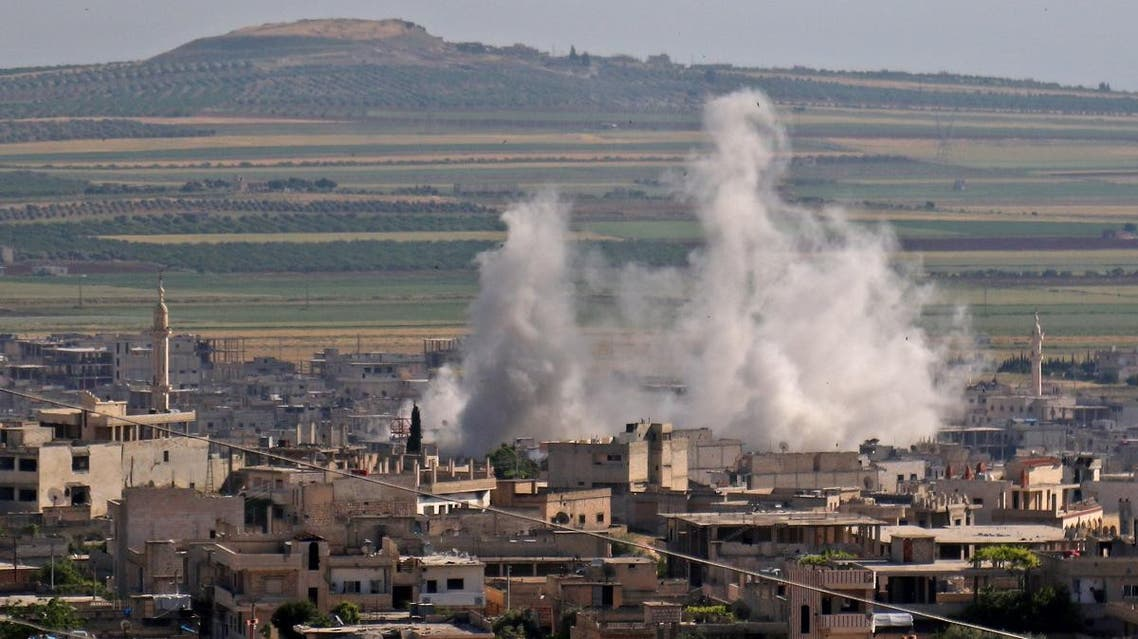 Smoke billows following regime bombardment on the town of Khan Shaykhun in the southern countryside of the rebel-held Idlib province on May 14, 2019. (AFP)