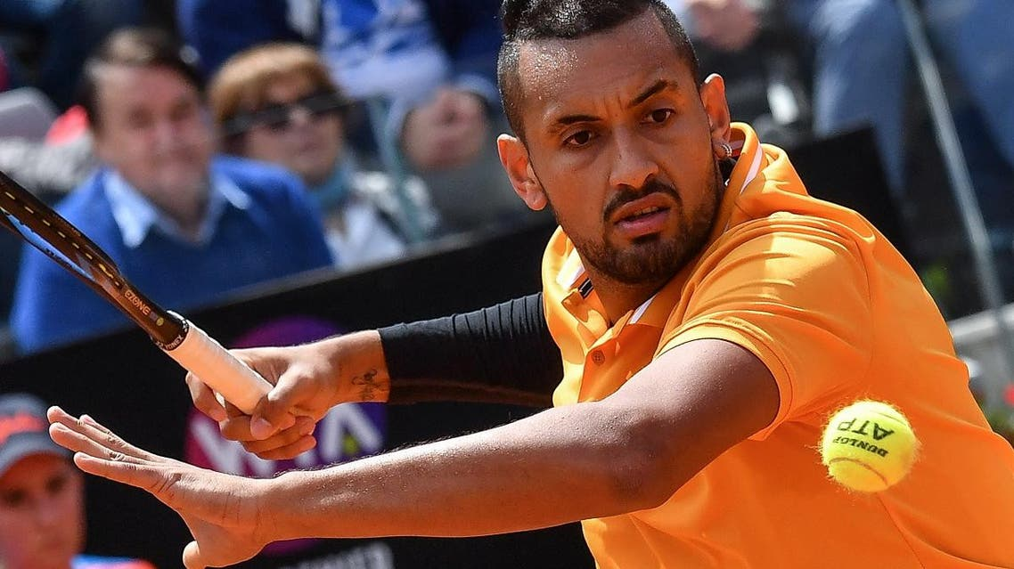 Nick Kyrgios returns the ball to Daniil Medvedev (unseen) during their ATP Masters tournament tennis match at the Foro Italico in Rome on May 14, 2019. (AFP)