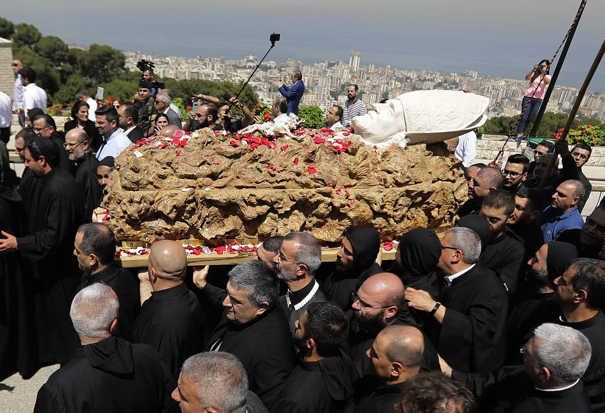 Lebanese monks carry the coffin of late Maronite Patriarch Cardinal Nasrallah Sfeir on May 15, 2019 at the Maronite Patriarchate in the mountain village of Bkerki, northeast of Beirut. (File photo: AFP)