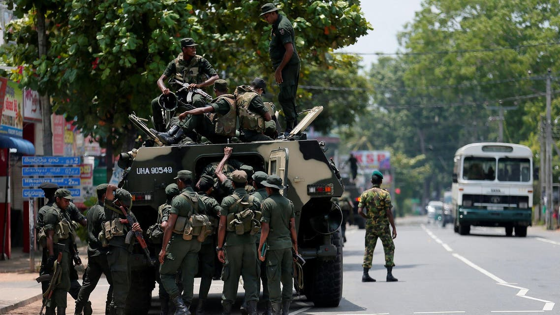 Sri Lankan soldiers patrol a road of Hettipola on top of an armored vehicle, after a mob attack in a mosque in the nearby village of Kottampitiya on May 14, 2019. (Reuters)
